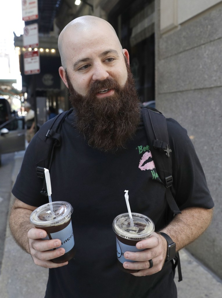 "Adam Taylor, a sound engineer from Las Vegas who bought iced coffees for friends Monday in Chicago: ""Coffee makes you happy"" and is something to look forward to in the morning."