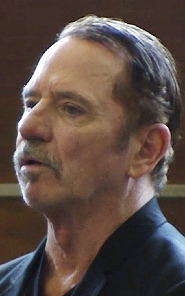 """TOM WOPAT this Aug. 3, 2017 file frame from video, actor Tom Wopat stands during arraignment in Waltham, Mass., on indecent assault and battery and drug possession charges. The former star of """"The Dukes of Hazzard"""" television show pleaded guilty to inappropriately touching two women in the cast of a musical in Massachusetts in which he starred. Prosecutors said Wopat was sentenced Friday, July 20, 2018, to a year of probation. (WCVB-TV via AP, Pool, File)"""