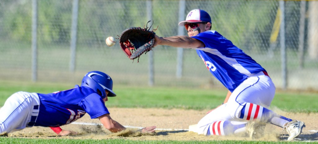 Waterford, Connecticut's Mike Marelli, left, dives back to first in time to beat a pick-off throw to Augusta first baseman Nick Barber during the Babe Ruth New England Regional tournament Friday in Augusta.