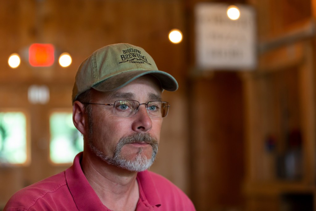 Jeff Powers, owner, sits in the tasting area at Bigelow Brewing Co. on Monday in Skowhegan.