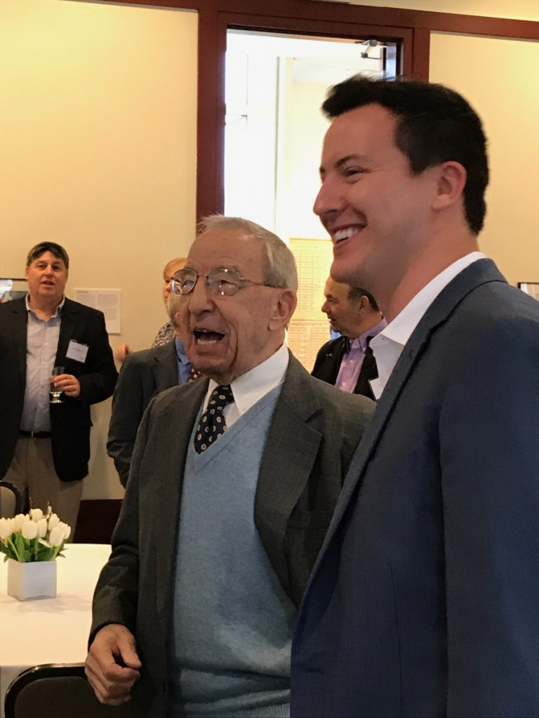 "John ""Swisher"" Mitchell, left, laughs with Colby College alumnus Mac Simpson during a ceremony that endowed the Colby men's basketball assistant coaching position in his name. Mitchell died Wednesday."