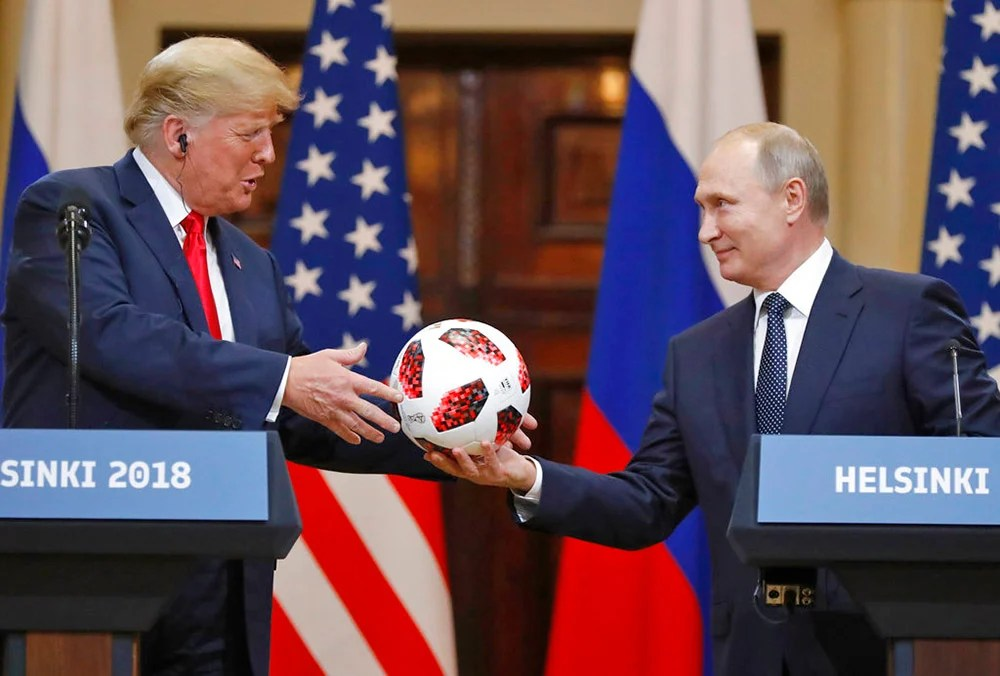 Russian President Vladimir Putin gives a soccer ball to President Trump during a press conference after their meeting at the Presidential Palace in Helsinki, Finland, on July 16, 2018.