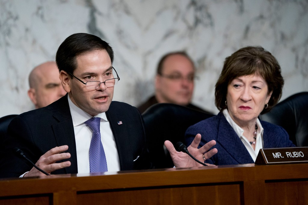 Sen. Susan Collins, R-Maine, is co-sponsoring a measure introduced by Sen. Marco Rubio, R-Fla., left, shown with her at a March meeting, and Sen. Chris Van Hollen, D-Md.  The bill would require tough sanctions within 10 days of a declaration by the director of national intelligence that Russia was interfering in an American political campaign.