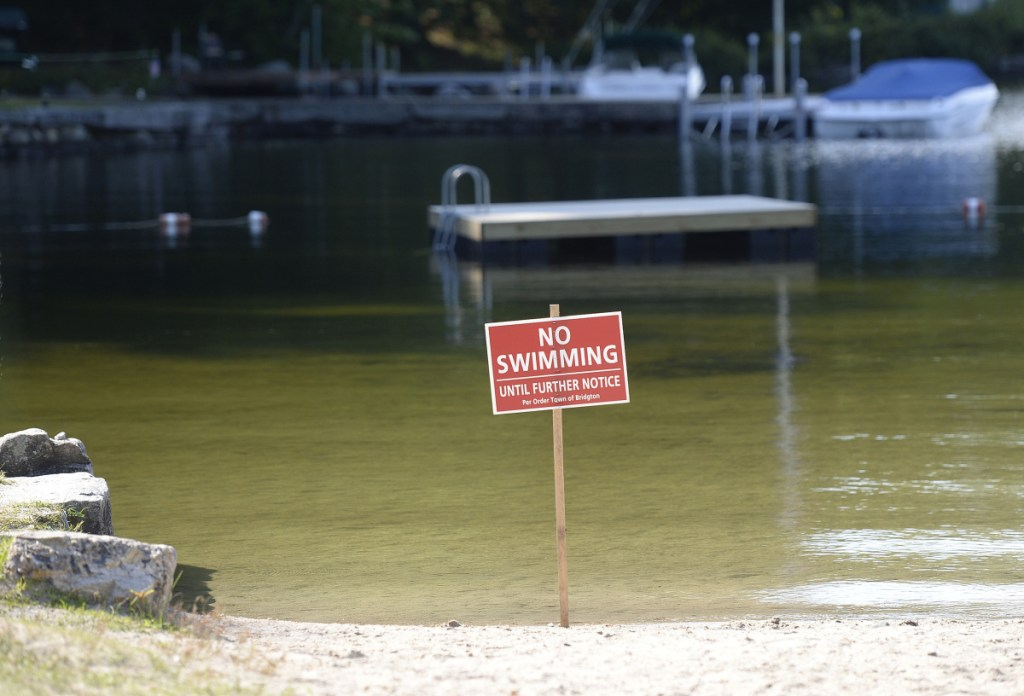 The town of Bridgton closed Highland Lake Beach to swimming Friday for the second time this summer because of high levels of E. coli in the water, but it has reopened after tests showed the E. coli count had dropped.