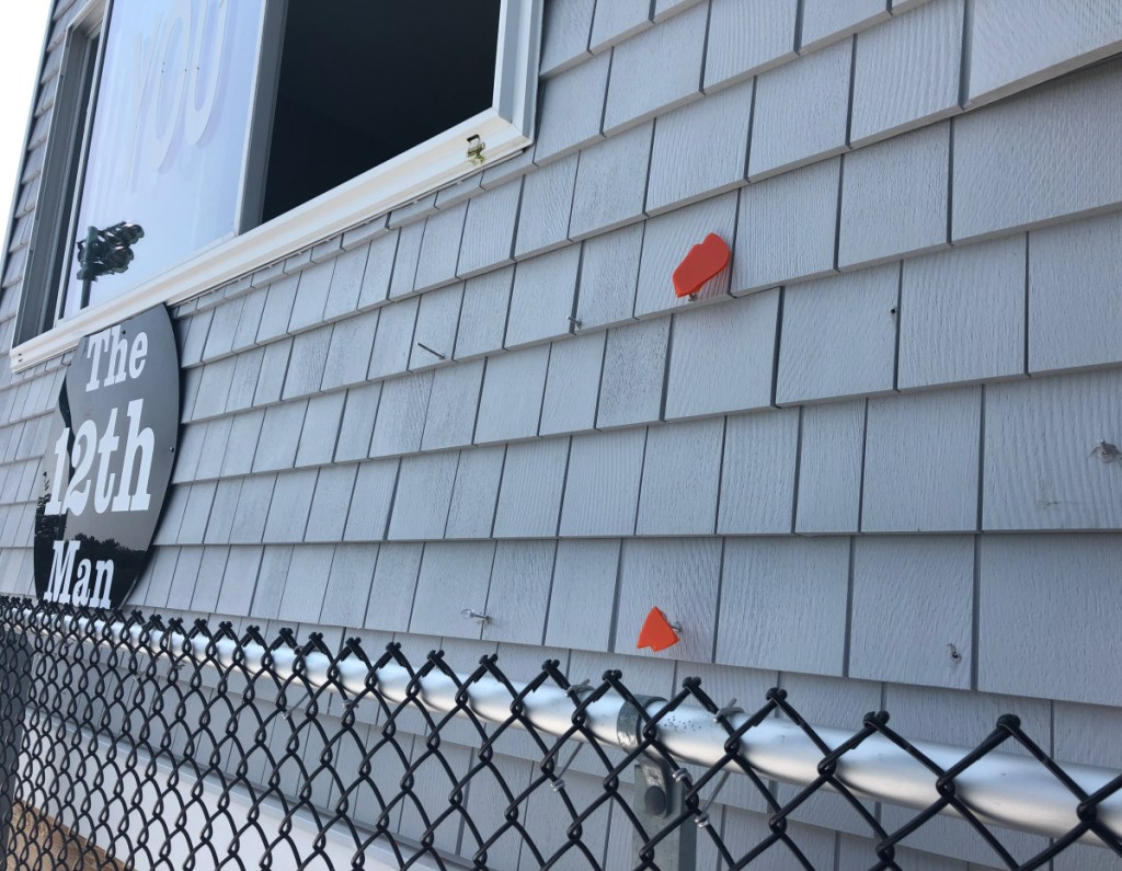 "Bits of the ""Tiger Pride"" sign and nails mark the place where it hung before it was stolen from Waterhouse Field in Biddeford late Thursday."