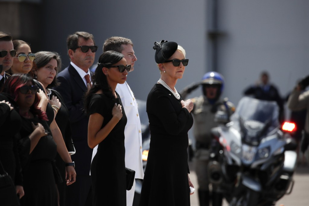 Cindy McCain, wife of U.S. Sen. John McCain, and her family members pay respects as the casket of McCain is loaded onto a Boeing C-32 military aircraft at the airport Thursday in Phoenix. McCain will lie in state at the U.S. Capitol on Friday before a memorial service at the National Cathedral on Saturday and then being buried at the U.S. Naval Academy Cemetery in Annapolis, Md., on Sunday.