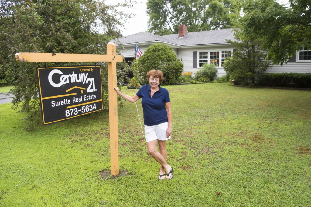 Cathy Taylor shows her home which is up for sale on Merrill Street in Waterville on Saturday. Across Waterville, other residents are also tapping into what some say is the best housing market the city has seen in years.