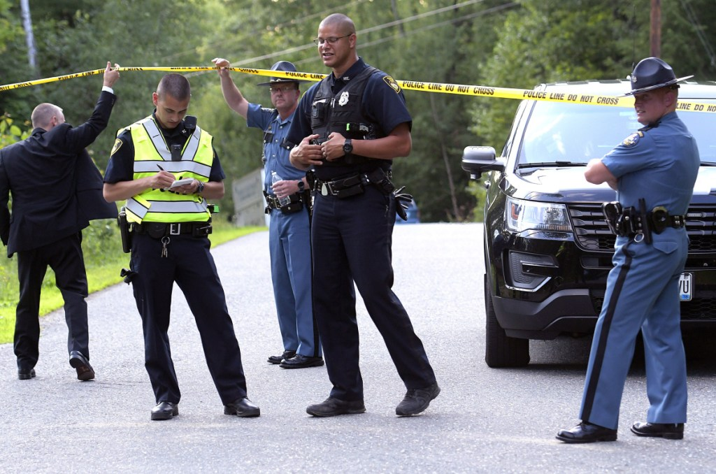 Maine State Police and Gardiner police gather Thursday evening at an incident involving two deaths on Timberwood Drive in Gardiner.