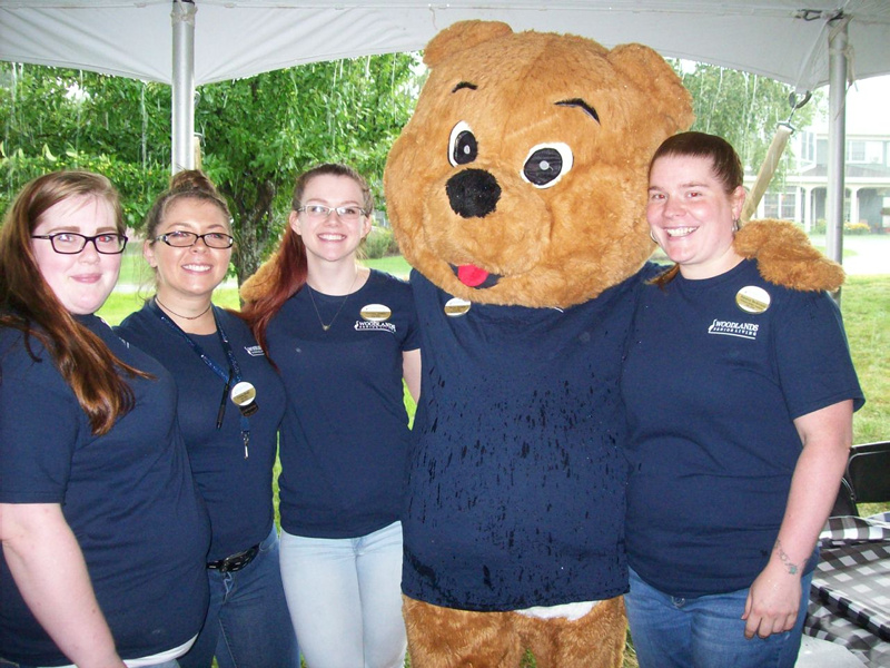 "<a href=""http://www.woodlandsmaine.com"">Woodlands Senior Living</a> held a First Responder Appreciation event honoring local first responders on Aug. 15 at the organization's Waterville location. Woodlands Senior Living staff from left are Paxton Picard, Emma Bean, Lindsey Giggey, Woody the Bear and Rayann Nickerson."