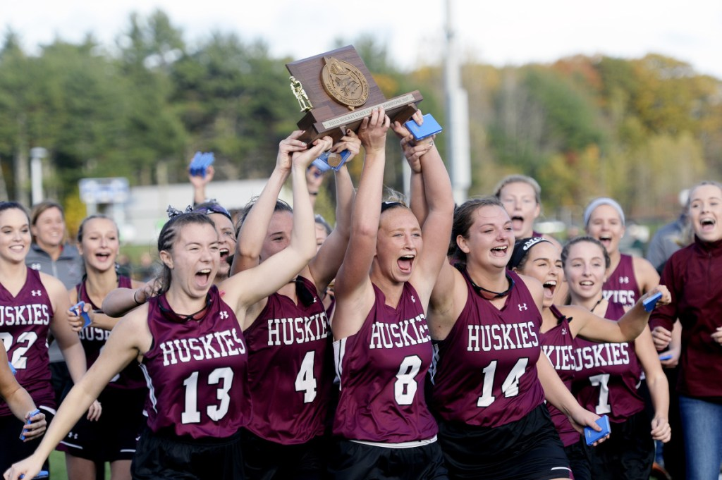 Maine Sunday Telegram photo by Shawn Patrick Ouellette   The MCI field hockey team celebrates after winning the Class B state championship last season over York at Falmouth High School.