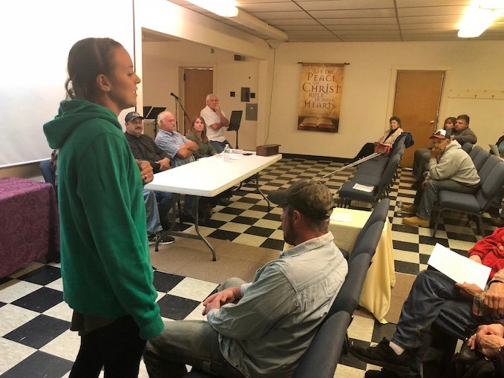 Kassie Dwyer, a 29-year-old Athens farmer, mother and schoolteacher, explains the town's food sovereignty initiative Tuesday night at a special town meeting. The measure passed with no opposition.