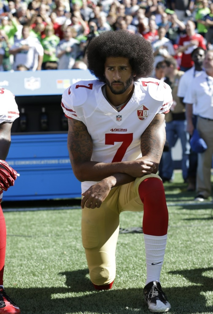 Colin Kaepernick kneels during the national anthem at a San Francisco 49ers game in 2016.