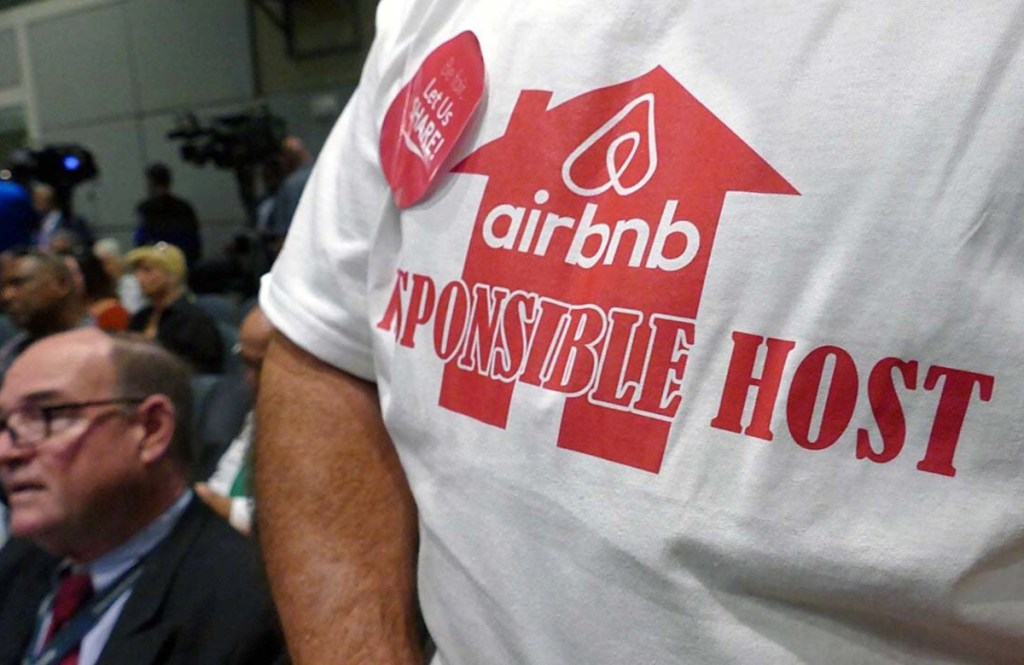 An Airbnb supporter speaks at a Miami meeting. Miami Beach is considering new measures to fight illegal short-term rentals.