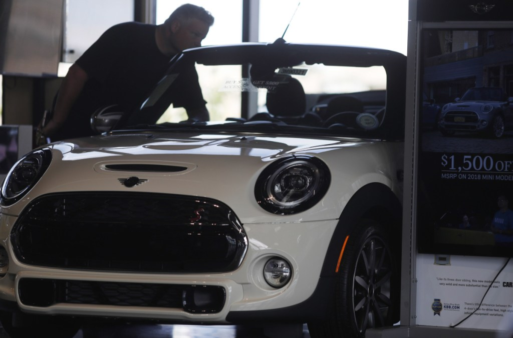 A prospective buyer looks over a 2019 Mini Cooper S convertible on the showroom floor of a dealership in Highlands Ranch, Colo., late last month. The Commerce Department said retail sales rose just 0.1 percent in August.