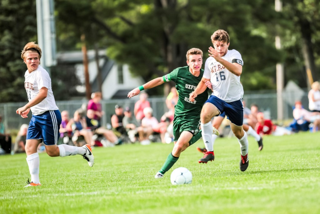 Mt. Blue defender Dom Giampietro keeps Oxford Hills' Spencer Strong away from the ball during the first half at Gouin Athletic Complex in Paris on Tuesday.