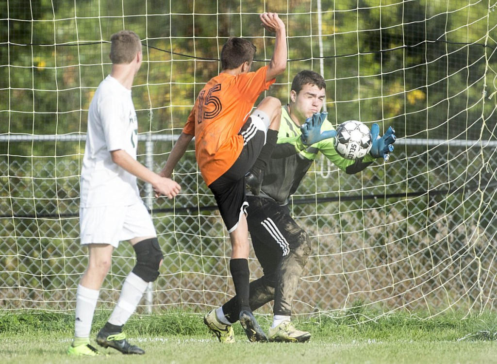 dfcd15786 Mount View goalie Ricky Nelson (51) makes a save as Winslow's Isaac Burbank  (