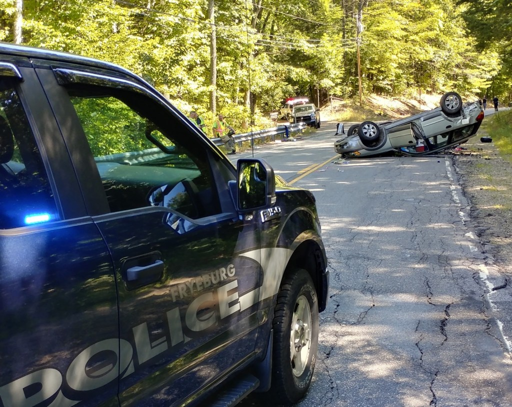 One of the vehicles involved in a crash on Route 302 in Fryeburg on Saturday rests on its roof. A woman and child were in critical condition on Saturday at a Portland hospital.