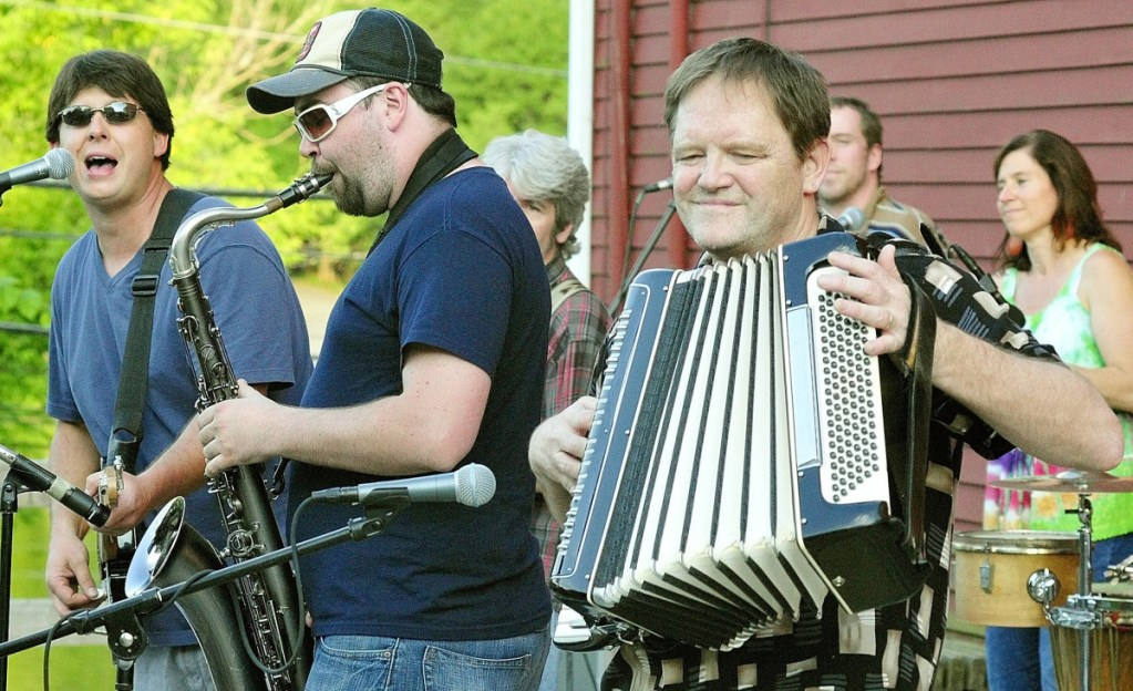 Tim Sullivan, left, Tyler Card and Bob Colwell perform songs by Paul Simon during a Rock on The River concert June 21, 2011, in downtown Hallowell.