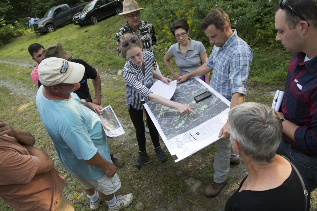 Liz Peyton, project manager for NextEra Energy, gives a tour of the proposed solar power project on Sandy Hill Farm to residents in Farmington on Aug. 29. A public hearing Monday provided Farmington residents the opportunity to comment on the proposed 490-acre solar farm.