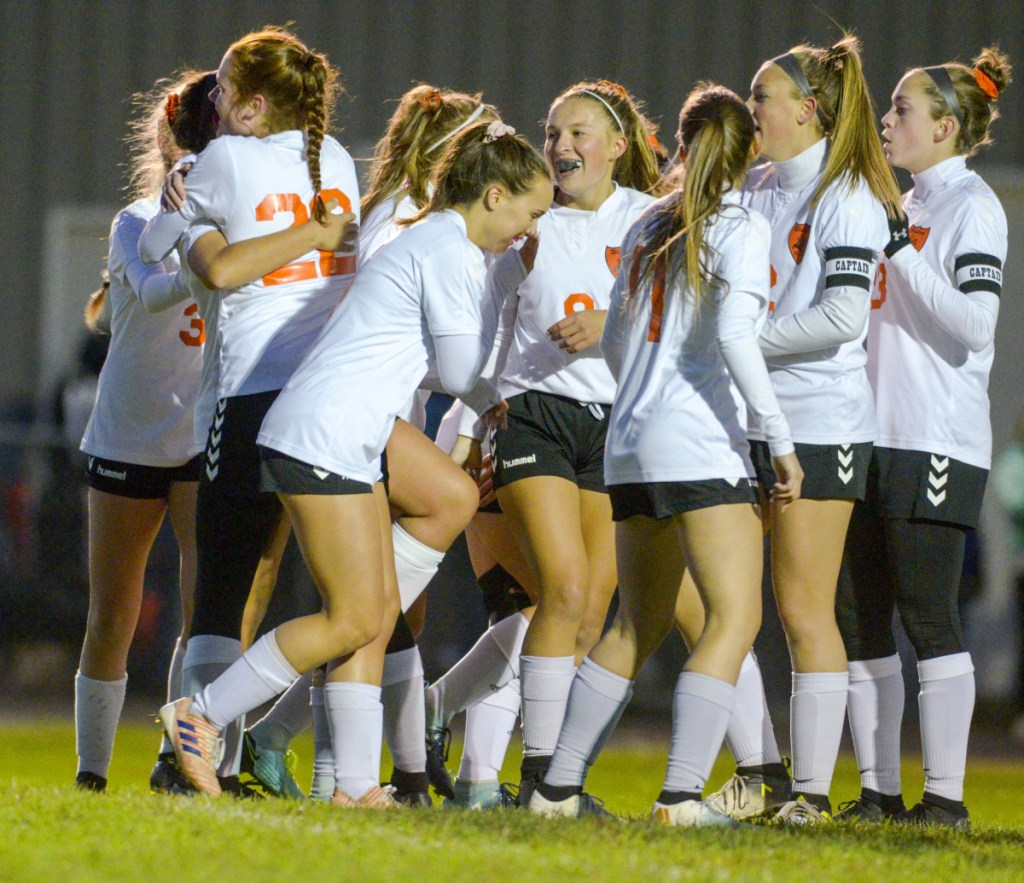 The Black Raiders celebrate after Desiree Veilleux scored a goal for a 1-0 lead against Maranacook on Tuesday in Readfield.