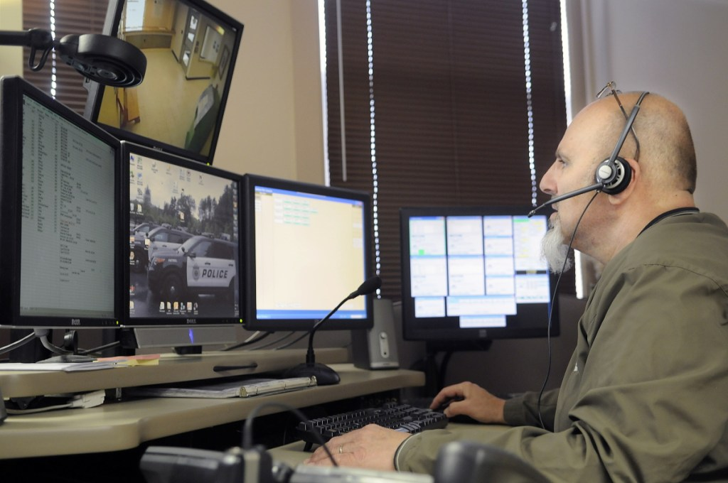 City of Augusta dispatcher Mike Rankins speaks with police officers while handling a radio call at the City's emergency communications center on April 16, 2015. The contracts of more than 20 Kennebec County towns that contract for law enforcement dispatch services with the state-run Regional Communications Center through the Kennebec County Sheriff's Office will expire in June 2019. The Augusta police dispatch service has been discussed as an alternative, but that might be an expensive proposition.