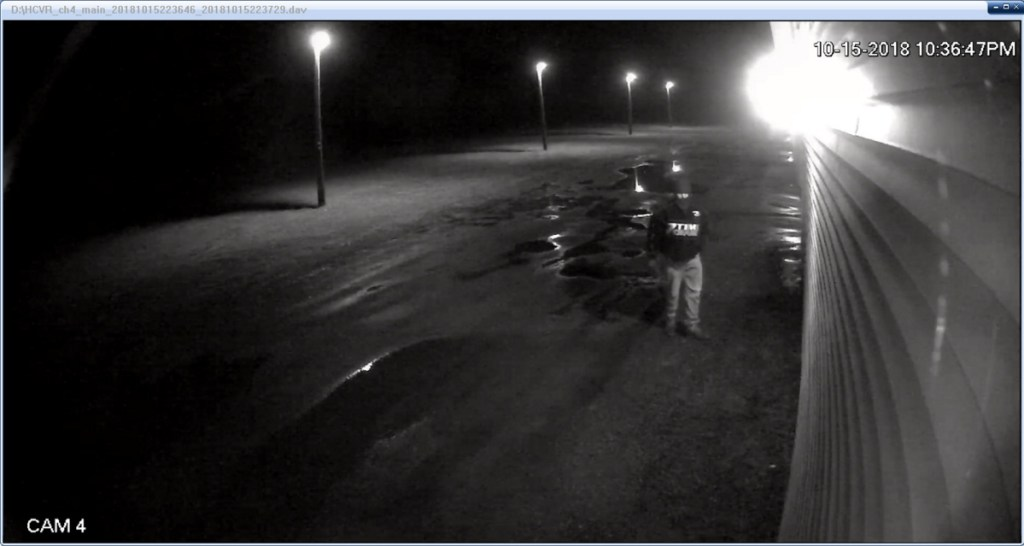 A surveillance camera at R&D Self Storage captured an image of a man wearing a Dale Earnhardt jacket and ski mask who is suspected of arson at the business.