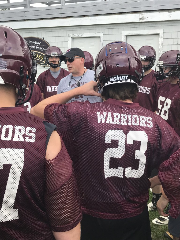 Staff file photo by Michael G. Seamans Nokomis head coach Jake Rogers talks to his players before a practice earlier this season in Newport. The Warriors play rival Maine Central Institute on Friday night in Pittsfield.