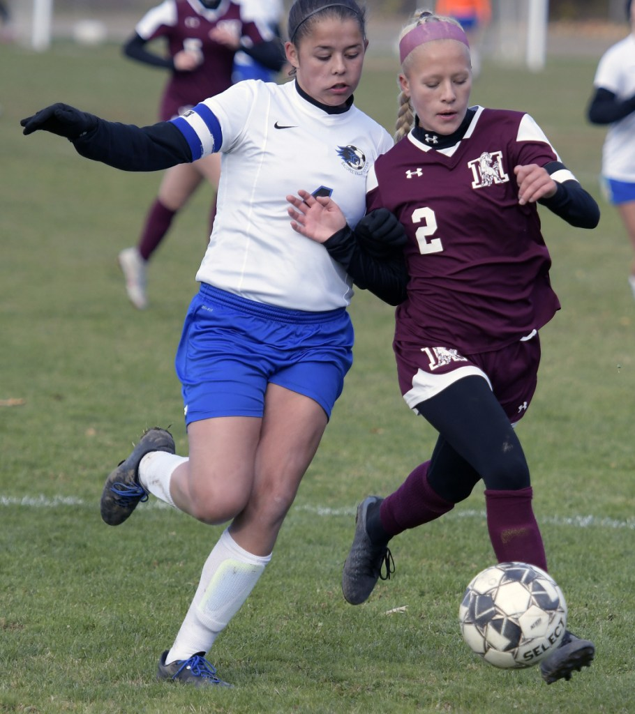 Monmouth's Audrey Fletcher, right, collides with Sacopee Valley's Lindsey Hendricks during a Class C South quarterfinal game Thursday in Monmouth.
