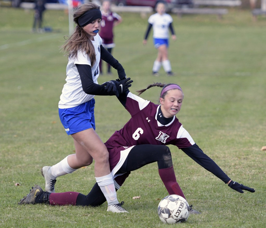 Monmouth's Libby Clement, right, is pushed by Sacopee Valley's Gabbi Black during a Class C South quarterfinal game Thursday in Monmouth.