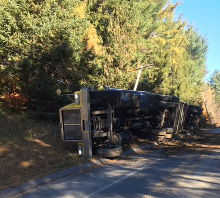 A southbound tractor-trailer went off a curve Friday morning on Route 150 in Athens near downtown and rolled onto its side. No one was injured.