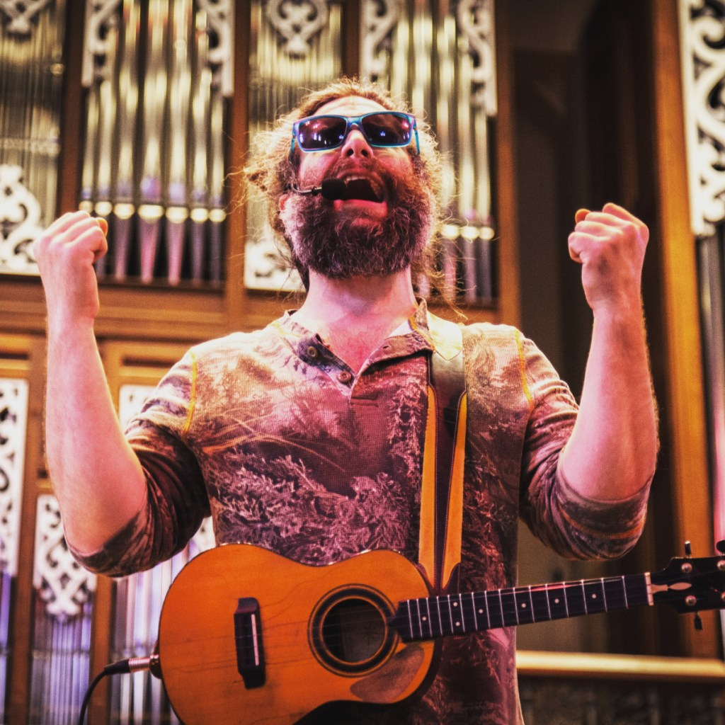 Maine native Russell Copelin, who performs under the stage name Ukulele Russ, during a recent show. He has been touring full time for 13 years and, he says, breaking ukulele stereotypes. There are no Hawaiian shirts and rainbow songs here.