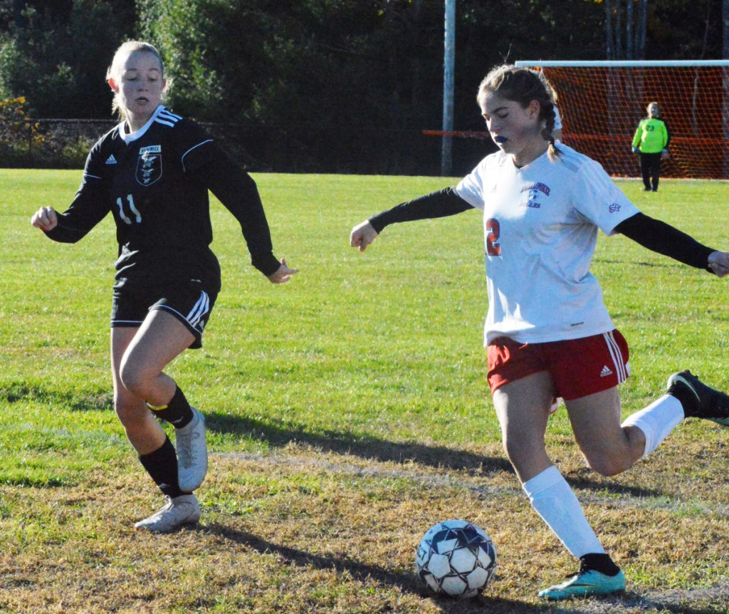 Messalonskee midfielder Natalie Tracy, right, dribbles up the field with Brunswick's Marley Groat in pursuit during last week's Class A North semifinal game in Brunswick.