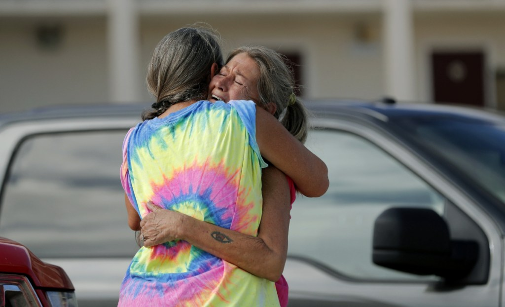 Nancy Register, right, weeps as she is comforted Wednesday by Roxie Cline, after she lost her home to Hurricane Michael in Mexico Beach, Fla.
