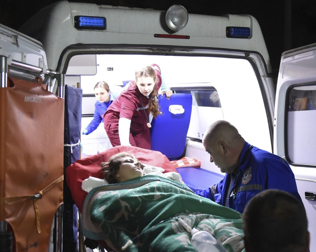 Medics load an injured person onto an ambulance in Kerch, Crimea, on Wednesday.