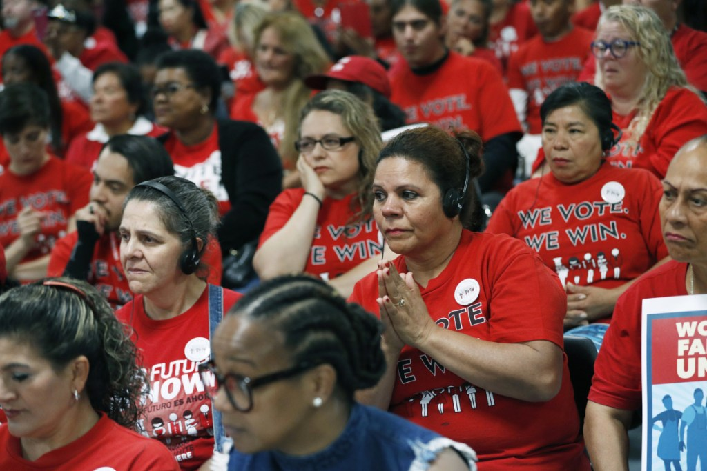 Members of the Culinary Union listen to Democratic candidates during an Oct. 17 event at the union hall in Las Vegas. Latinos have a spotty track record in midterm elections. The Democrats need heavy Latino support to win several Senate races and take back control of the House. (Associated Press/John Locher)