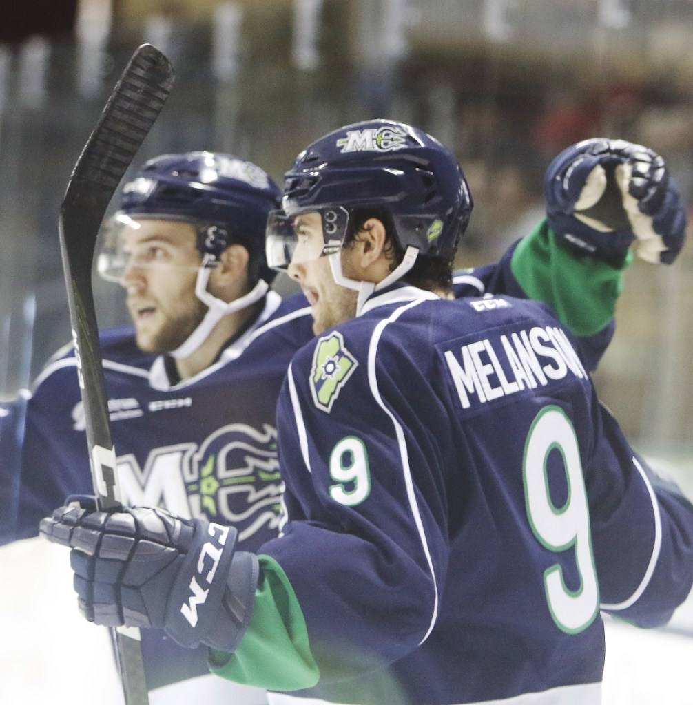 Drew Melanson of the Maine Mariners celebrates his first-period goal with teammate Derek Pratt during a 4-2 victory against the Newfoundland Growlers at the Cross Insurance Arena on Sunday.