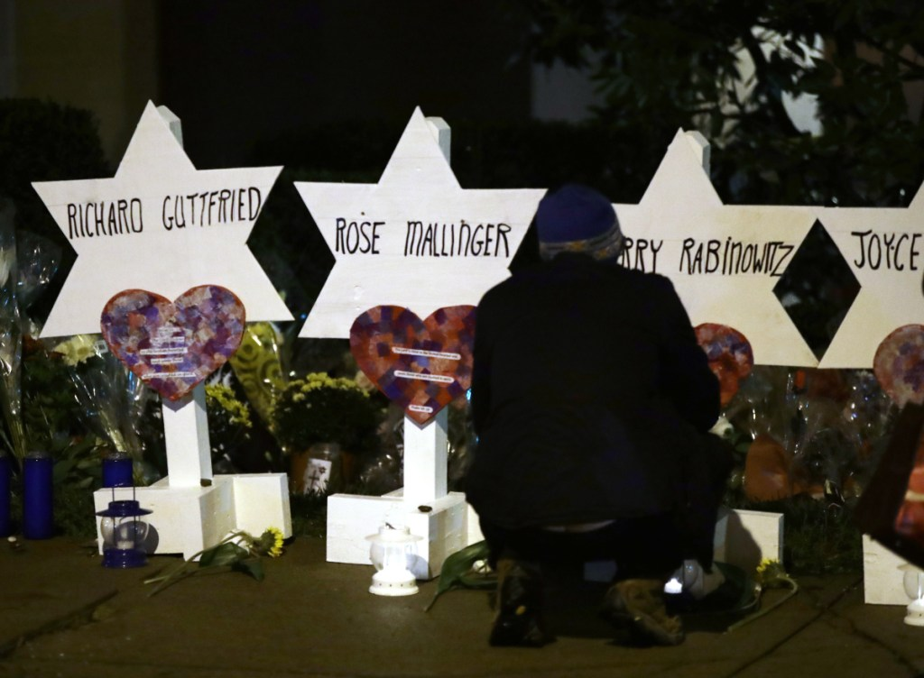 Stars of David with the names of those killed in a deadly shooting at the Tree of Life Synagogue stand in front of the synagogue in Pittsburgh on Sunday.