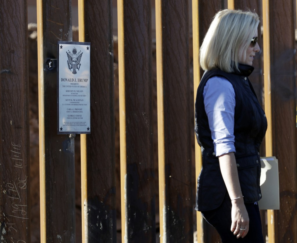 U.S. Department of Homeland Security Secretary Kirstjen Nielsen inspects a newly fortified border wall structure Friday in Calexico, Calif.