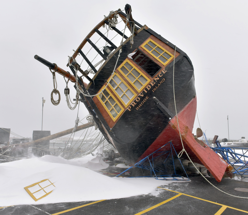 Newport, R.I., took the full brunt of a blizzard, which toppled the tall ship replica of the USS Providence on the dock, breaking the mast and puncturing the hull, in 2015.