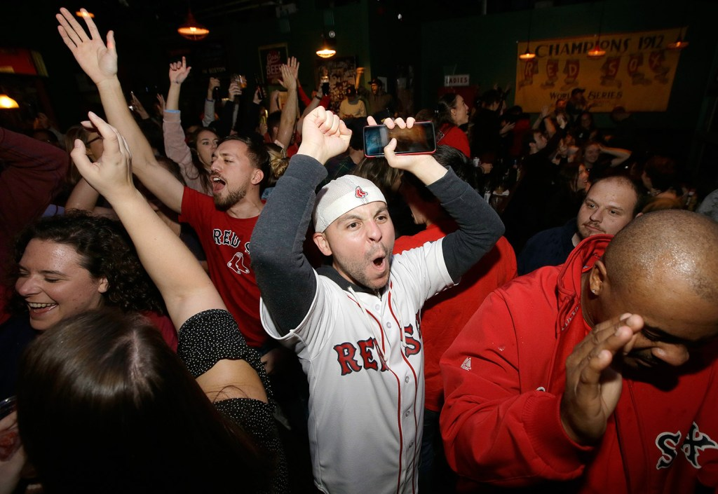 Red Sox fans celebrate their team's World Series-clinching win Sunday night in Boston. Next up: another duck boat parade.