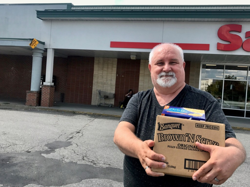 Dennis Mills, 63, of Waterville, pictured outside Save-A-Lot on Aug. 15, said he supports a proposed ordinance that would ban plastic shopping bags at large retailers.