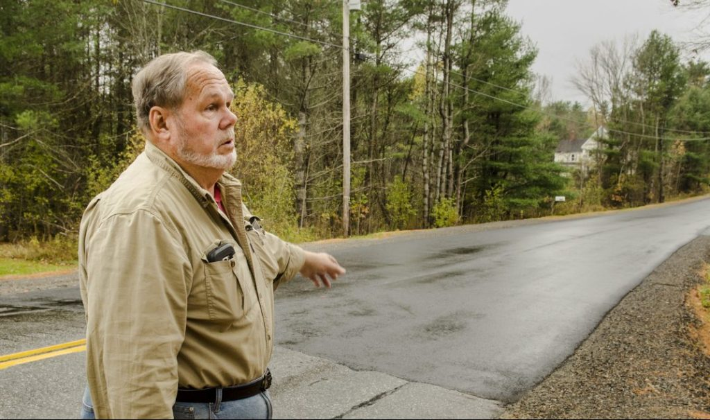 Farmingdale Road Commissioner Steve Stratton talks on Thursday about the pavement level on a recently repaired section of Northern Avenue in Farmingdale.