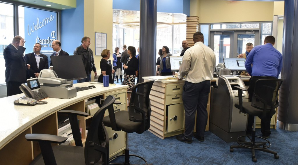 Customers are assisted as officials fill the lobby of the new Camden National Bank for a grand opening celebration Monday at the Bill & Joan Alfond Main Street Commons building in Waterville.