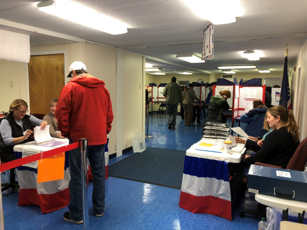 Deputy election clerks Julie Finley, left, Traci Britten and Aileen Pelkey, right, organize blank ballots Tuesday as China residents cast their votes at the portable building near the Town Office.