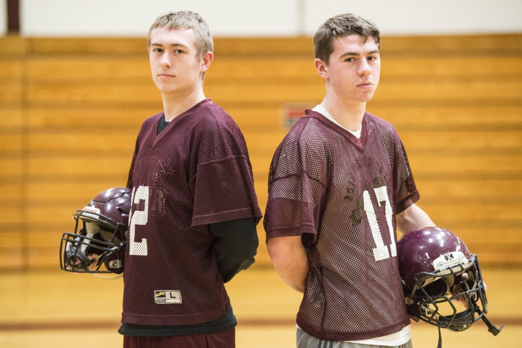 Brock Graves, left, and his cousin Chance Graves pose inside Nokomis Regional High School in Newport on Tuesday afternoon.