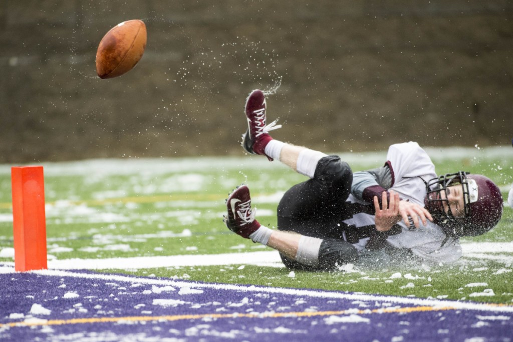 Staff photo by Michael G. Seamans   Nokomis' Tyler Pelletier can't hold onto a pass near the end zone against Hermon in the Class C North championship game Saturday at Hampden Academy.