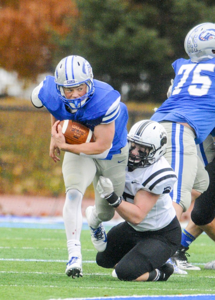 Colby running back Jake Schwern gets tackled by Bowdoin's Liam Dougherty on Saturday in Waterville.