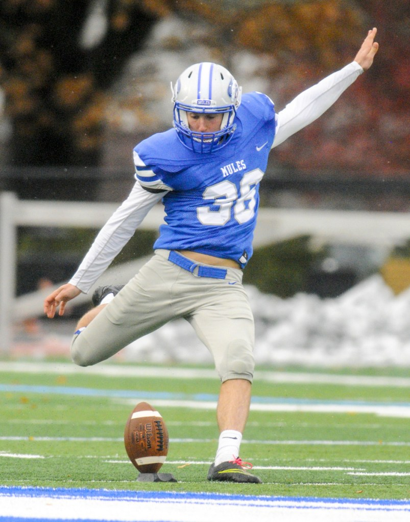 Colby kicker Walter Thilly kicks off against Bowdoin on Saturday in Waterville.