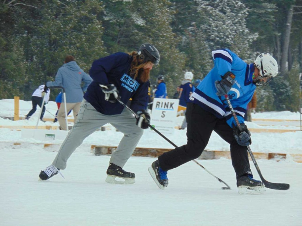 """Jared """"Jedi"""" Baker of Maine Cabin Masters, left, and Travis Ridky, of Camden National Bank compete in the 2018 tournament Feb. 9-11 in Sidney."""