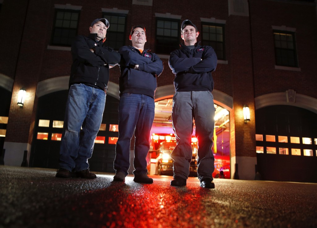 South Portland Deputy Fire Chief Bill Collins, center, with firefighters Luis Tirado, left, and Hale Fitzgerald, were among the five firefighters who rushed into a burning house on Kincaid Street on Wednesday night and found a 33-year-old woman who was trapped upstairs.